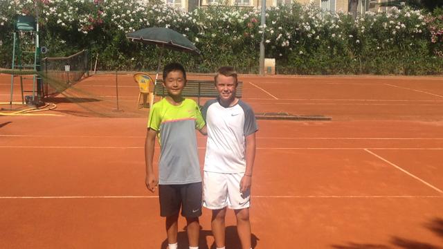 Alex Xiang Lu (CAN) og Holger Vitus Nødskov Rune