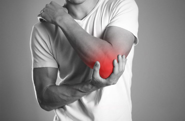 A man holding hands. Pain in the elbow. The hearth is highlighted in red. Close up. Isolated background