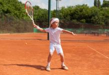 boy training tennis