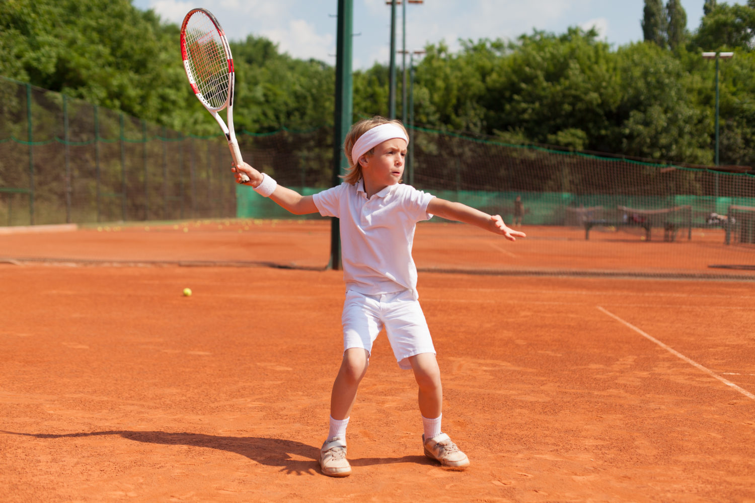 boy training tennis