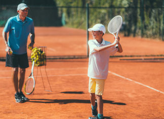 Tennis Lesson with Boy and Trainer